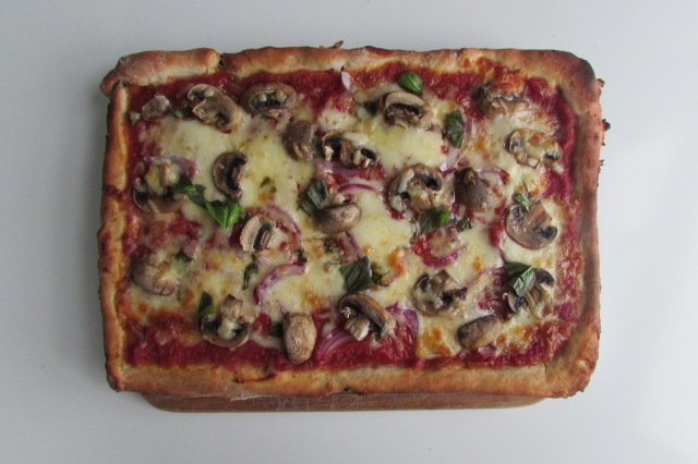 Mushroom and red onion pizza
